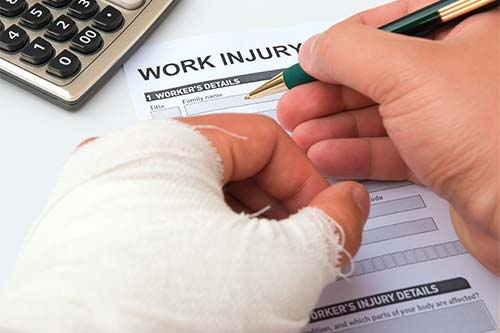 Injured hand signing workers compensation form